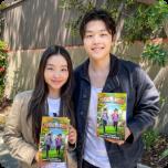 Maia and Alex Shibutani Holding Books