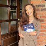 Meryl Davis holding a book