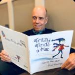 "Scott Hamilton Reading ""Fritzy Finds a Hat"""